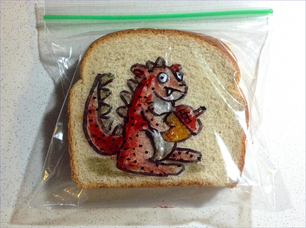 Sandwich Bag Art: A Red mutant squirrel holding an acorn