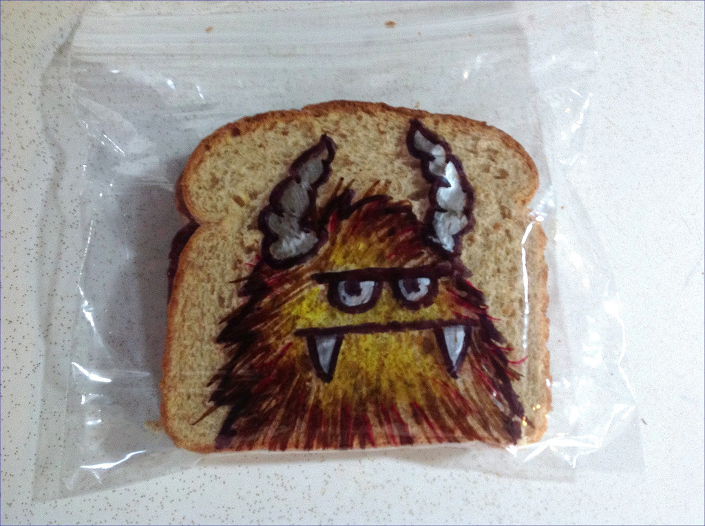 Sandwich Bag Art: Furry Orange Monster with horns and an overbite