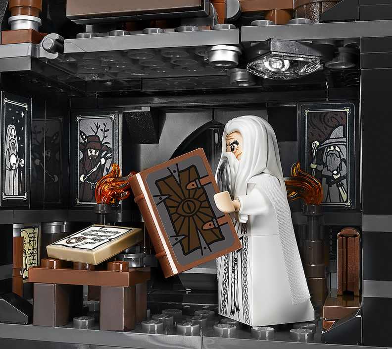 Saruman reading in the tower