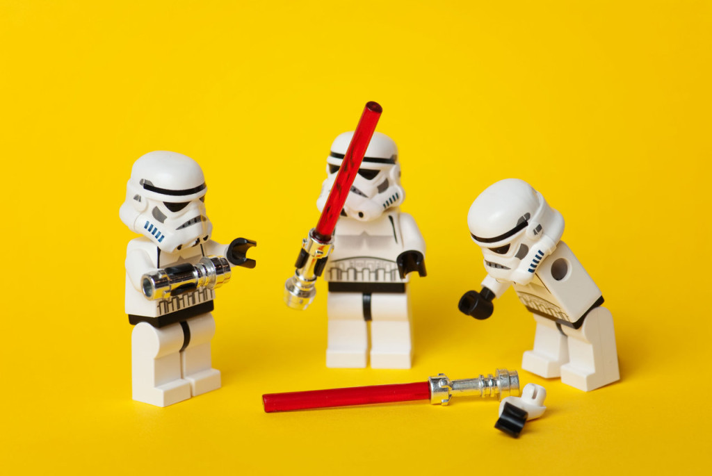 LEGO Stormtroopers playing with two lightsabers