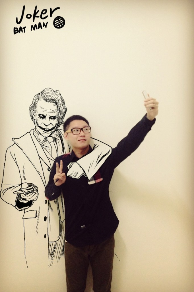 Taking a smartphone picture with The Joker