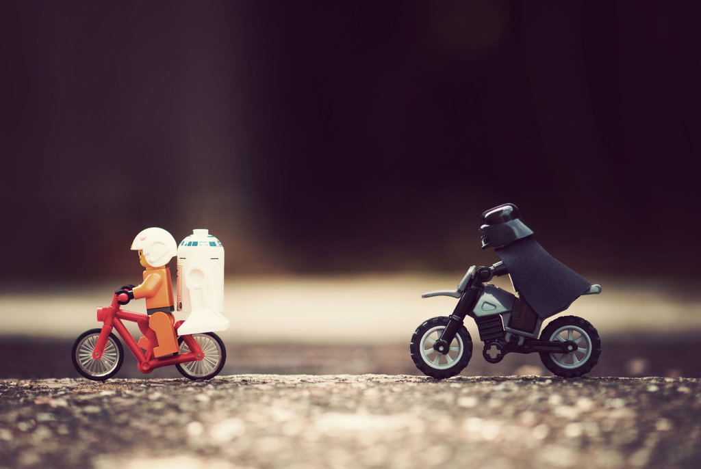 LEGO Darth Vader chasing Luke Skywalker and R2D2 on a bicycle