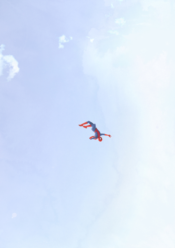 Spider-man whipping through the air over New York City