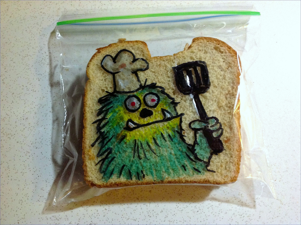 Sandwich Bag Art: Furry Green Monster Chef holding a spatula