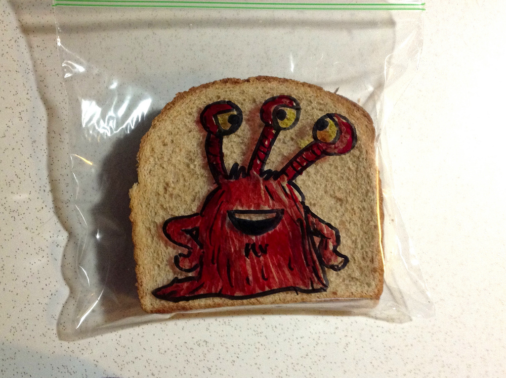 Sandwich Bag Art: A red three-eyed monster