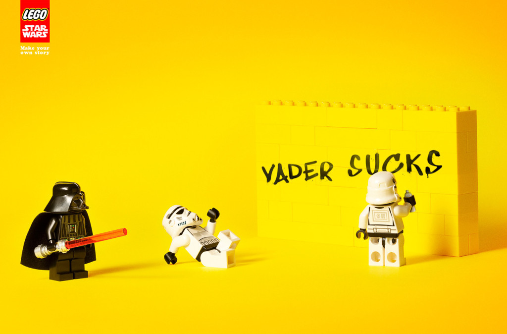LEGO Stormtrooper spraying Darth Vader Sucks on a wall