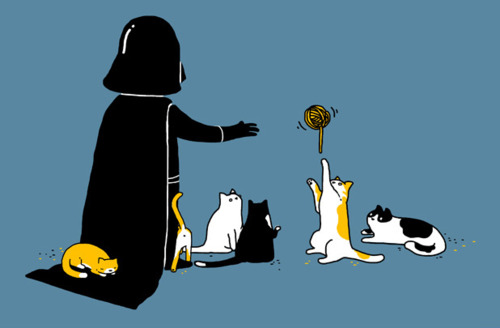 Darth Vader playing with cats